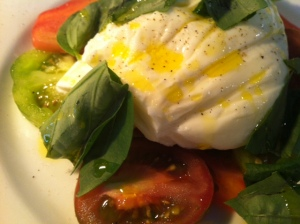 Burrata, a fresh Italian cheese enriched with a creamy, gooey centre