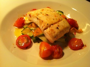 Roast Halibut with courgette, cherry tomatoes and a garlic and herb butter